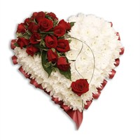 With Sympathy Flowers - Chrysanthemum Based Heart Edged with Red Ribbon 15 inch